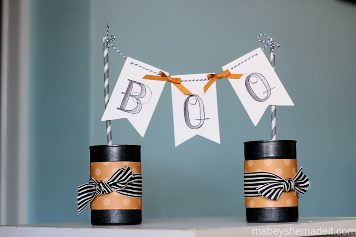 Cute! Just watercolor a simple Boo and use empty cans from around the house to make this cute pennant for near the candy bowl.