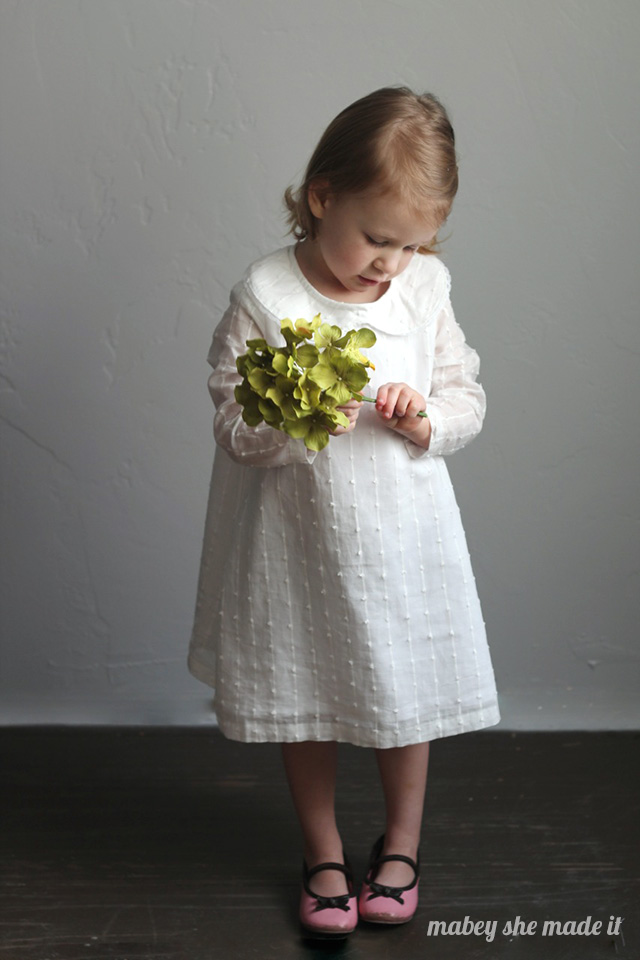 Such a sweet classic dress made from an upcycled sheet and curtain.