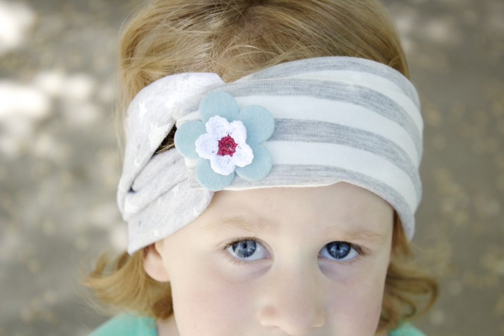 It's a subtle take on Fourth of July patriotic accessories. Learn to make this twisted knit headband with Mabey She Made It.