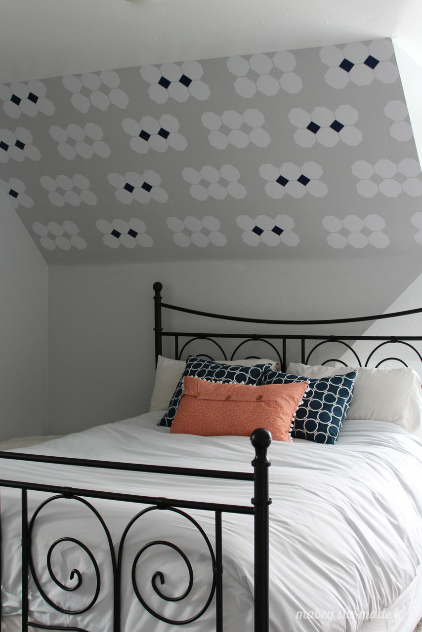 13 ideas for decorating with a sloped ceiling mabey she - Decorating walls with pictures ...